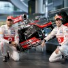 Veteran Vodafone McLaren driver Jenson Button and new teammate Sergio Perez show off the 2013 McLaren MP4-28.