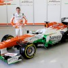 Sahara Force India driver Paul di Resta shows off the Force India VJM06.